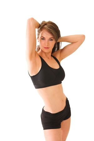 Middle aged lady in her late thirties measuring warming up before starting her workout in the gym, she is very happy with her achievements.