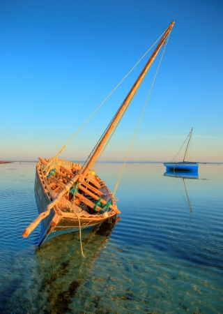 beautiful dhow or traditional fishing sailing boat in the water at the island on a dream summer vacation or holiday. Stock Photo