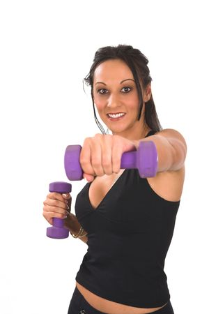 late thirties: Middle aged lady in her late thirties boxing with weights - she is exercizing hard with a smile