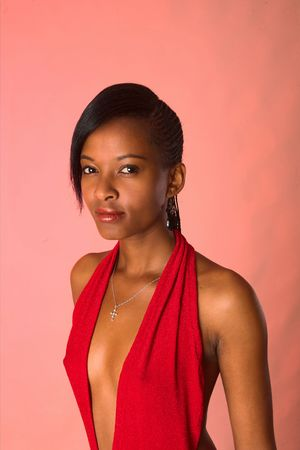 A beuatiful African lady in a sexy red evening dress.