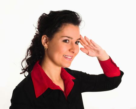 a Young air hostess with dark hair salutes, caucasian lady