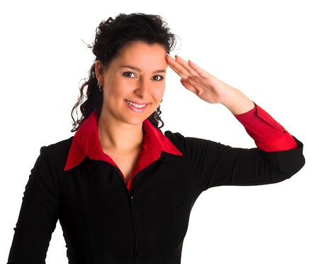 confirmed: a young air hostess is saluting others. She is dressed with a black jacket and is smiling, yes sir! Stock Photo