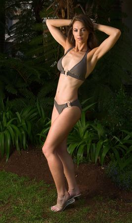 a beautiful middle aged lady shows of her well sculpted and trained body