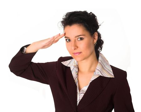 a beautiful mid 20s brunette is saluting her boss or captain. Subordinance. Obedience. Stock Photo