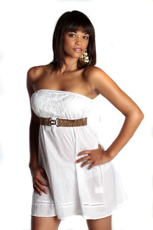 a brunette model is posing in a white dress, not caucasian, nor african american, colored.
