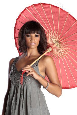 an elegant brunette lady is holding a pink reddish umbrella. isolated on white photo Stock Photo