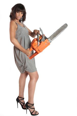 a brunette is dressed to kill and she is holding a chainsaw to punctuate the fact