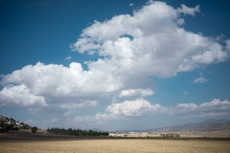 sunny landscape with spectacular clouds and blue sky of the plains of the State of Hidalgo