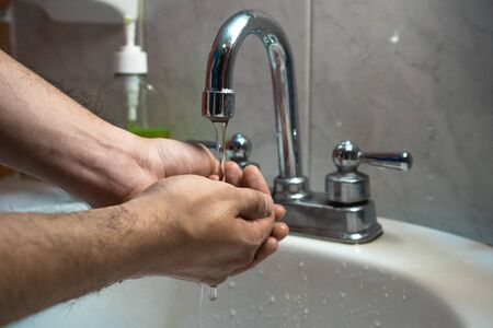 taking the correct handwash in the sink in house of Mexico City