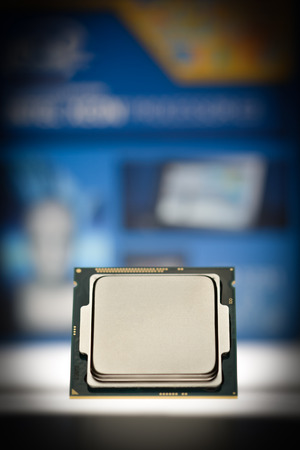 harddisc: Modern four or eight-core processor on original packaging background