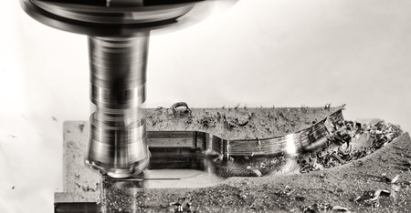 milling: Metal milling cutter work with Splinters flying off, monochrome version Stock Photo