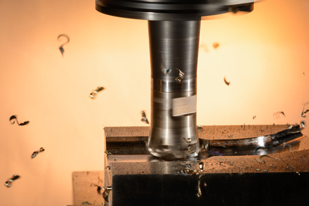 splinters: Milling cutter machine work with Splinters flying off on a light background, color version
