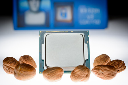 eight-core processor on original packaging background When the cores are symbolized by nut cores