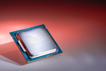harddisc: Modern processor of a red light background FORMED
