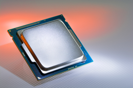 Modern processor of a light orange background FORMED