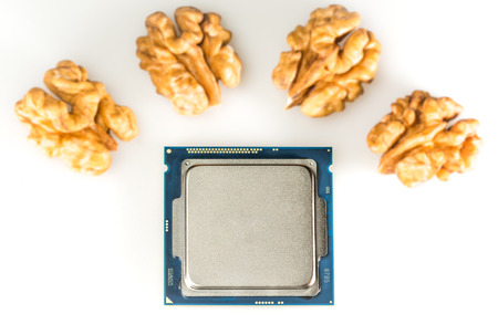 harddisc: four-core processor on light background When the cores are symbolized by unfocussed nut cores Stock Photo