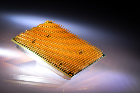 modern processor with authentic reflection and background Formed by colored light Stock Photo