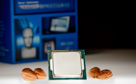 harddisc: four-core processor on original packaging background When the cores are symbolized by nut cores