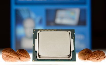 four-core processor on original packaging background When the cores are symbolized by nut cores