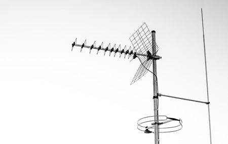 polarization: directional antenna for reception of digital television broadcasting DVB-T and DVB-T2 on a white background  (horizontal polarization, UHF, Delayed conductor, FM antenna) Stock Photo