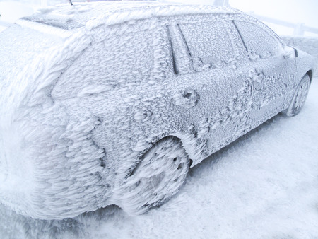 car with a layer of frost after snowstorm