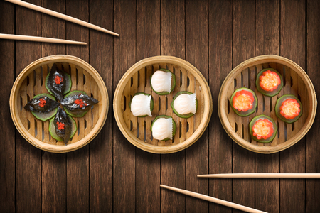 Dim sum dumplings on a wooden background Stock Photo