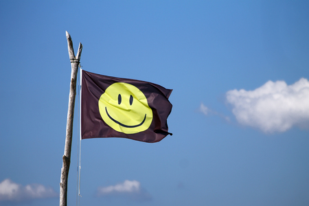 Smile flag waving in blue sky Stock Photo
