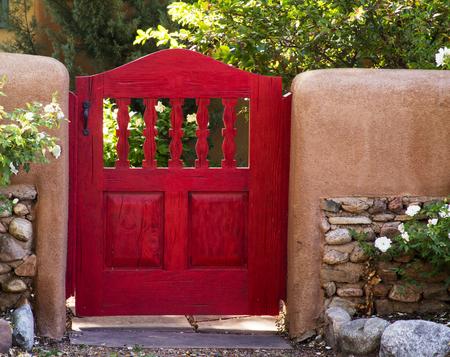 Bright Red Garden Gate Neat Canyon Road, Santa Fe, New Mexico Stock Photo