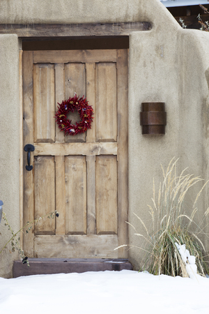 Wooden Entryway with Ristra Wreath in Santa Fe New Mexico
