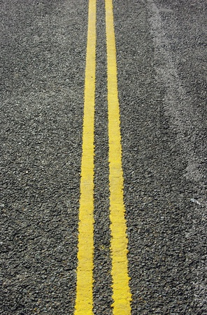 Double yellow lines on road Stock Photo