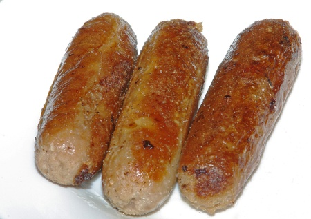 Cooked sausages on white dish Stock Photo