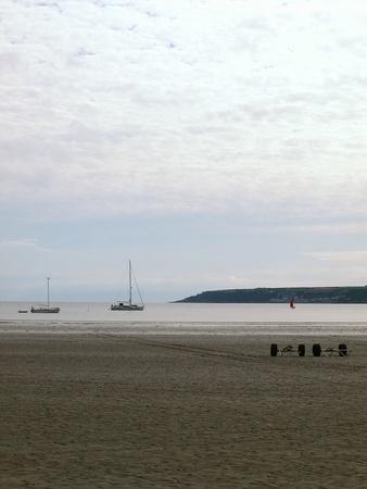 Beach and boats at sea