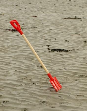 Spade on beach Stock Photo
