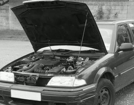 Car with hood up showing engine Stock fotó