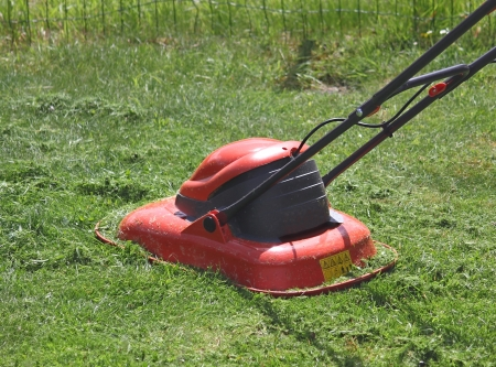 Lawn mower cutting grass Stock Photo - 14315247