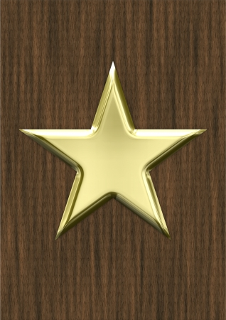 Gold star on wood background photo