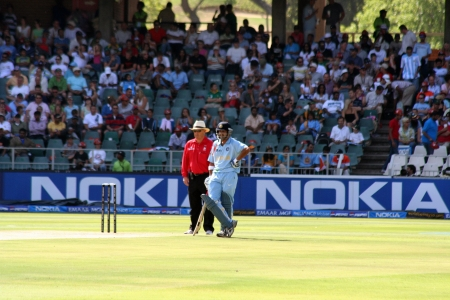 an umpire: Batsman and umpire at Twenty 20 cricket match in South Africa
