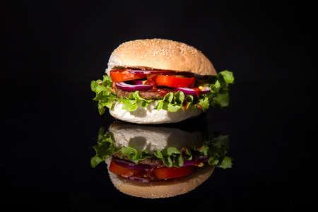 hamburger isolated on reflective black backgropund