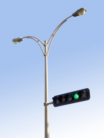 traffic light and lamps on blue sky