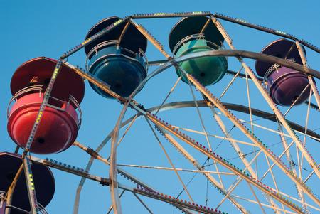 amusement park carousel on blue sky big wheel