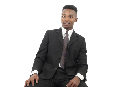 seated: businessman suit and tie seated on white background