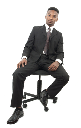 seated: Businessman seated on a chair on white background