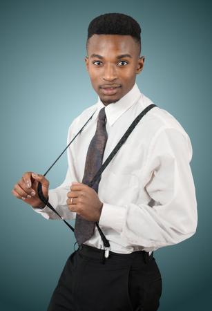 suspenders: businessman holding his suspenders, successful