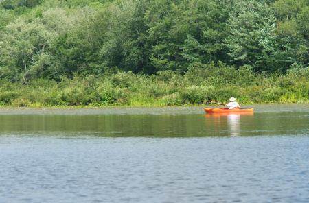 kayaker: kayak man, water sport, kayaker on red canoe, river view