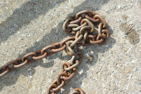 rusty chain: rusty chain on concrete rust metal