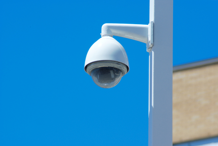 ip cam: security camera post outside on blue sky