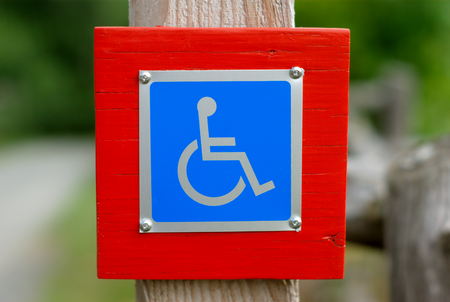 paralyze: wheelchair handicap sign disabled blue symbol Stock Photo
