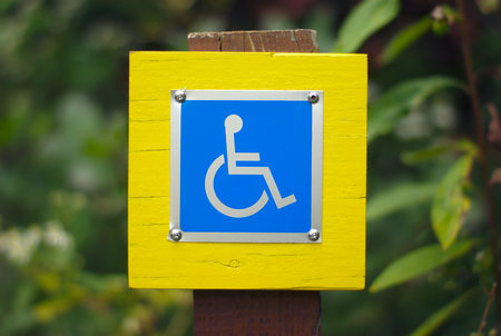 handicap sign: wheelchair handicap sign disabled blue symbol Stock Photo