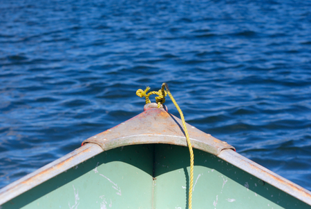 shallop: yellow rope in front of a shallop on a lake