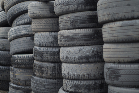 scrap heap: old worn out tires heap for recycling or scrap